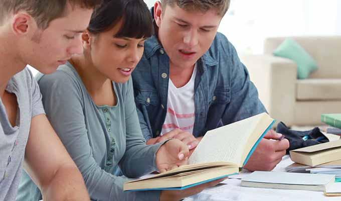 Via https://www.shutterstock.com/video/clip-2903341-stock-footage-smiling-friends-studying-together-in-a-bright-room.html