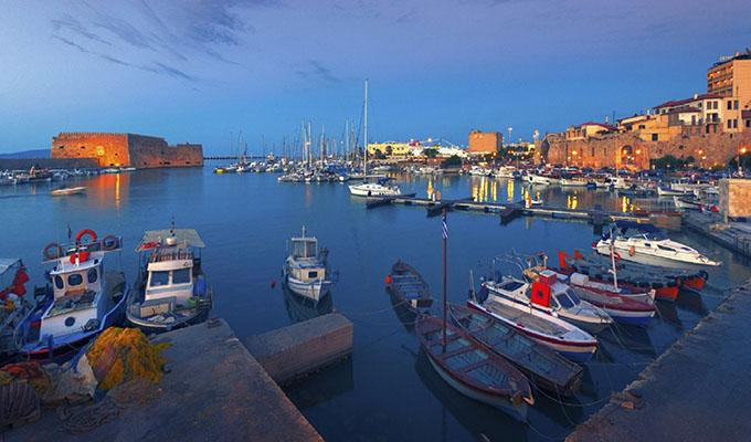 Via http://www.discovergreece.com/~/media/images/article-background-images/discovering-heraklion-crete/the-old-harbour-of-heraklion-in-crete-at-night.ashx?h=1200&la=en&w=1800